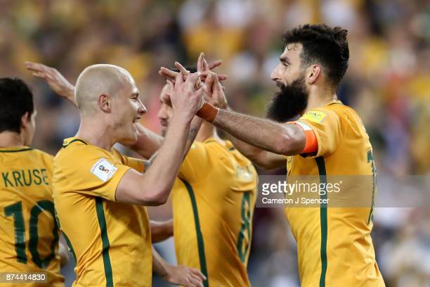 Mile Jedinak of Australia celebrates kicking a penalty with team mate Aaron Mooy of Australia during the 2018 FIFA World Cup Qualifiers Leg 2 match...