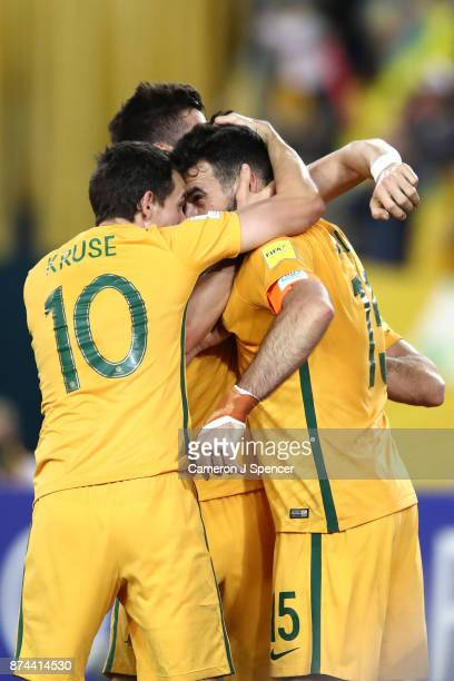 Mile Jedinak of Australia celebrates kicking a penalty with team mates during the 2018 FIFA World Cup Qualifiers Leg 2 match between the Australian...