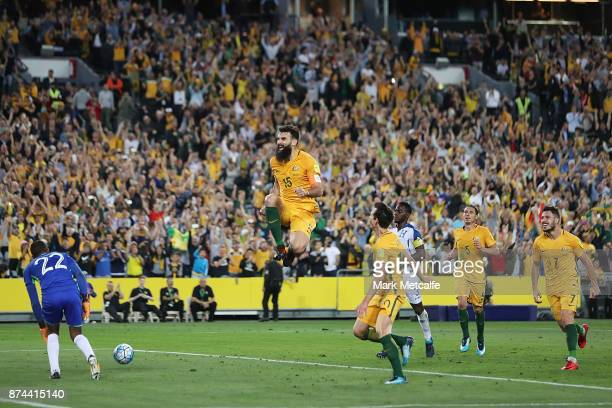 Mile Jedinak of Australia celebrates scoring a goal during the 2018 FIFA World Cup Qualifiers Leg 2 match between the Australian Socceroos and...