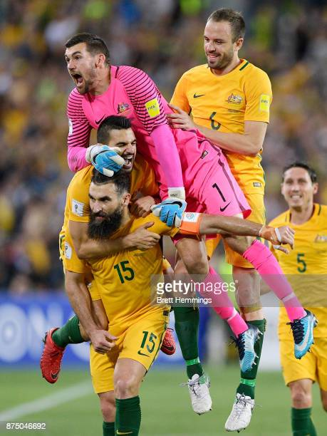 Mile Jedinak of Australia celebrates scoring a goal with team mates during the 2018 FIFA World Cup Qualifiers Leg 2 match between the Australian...