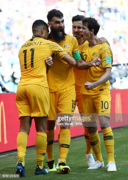 Mile Jedinak of Australia celebrates scoring his side's first goal from a penalty with team mates Andrew Nabbout Robbie Kruse and Mathew Leckie...