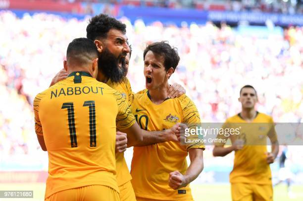 Mile Jedinak of Australia celebrates scoring his side's first goal with team mates Andrew Nabbout and Robbie Kruse during the 2018 FIFA World Cup...