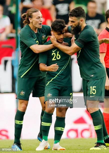 Mile Jedinak of Australia celebrates with goal scorer Daniel Arzani of Australia and Jackson Irvine of Australia during the International Friendly...