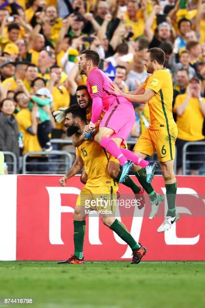 Mile Jedinak of Australia celebrates with his team mates after scoring his second goal during the 2018 FIFA World Cup Qualifiers Leg 2 match between...