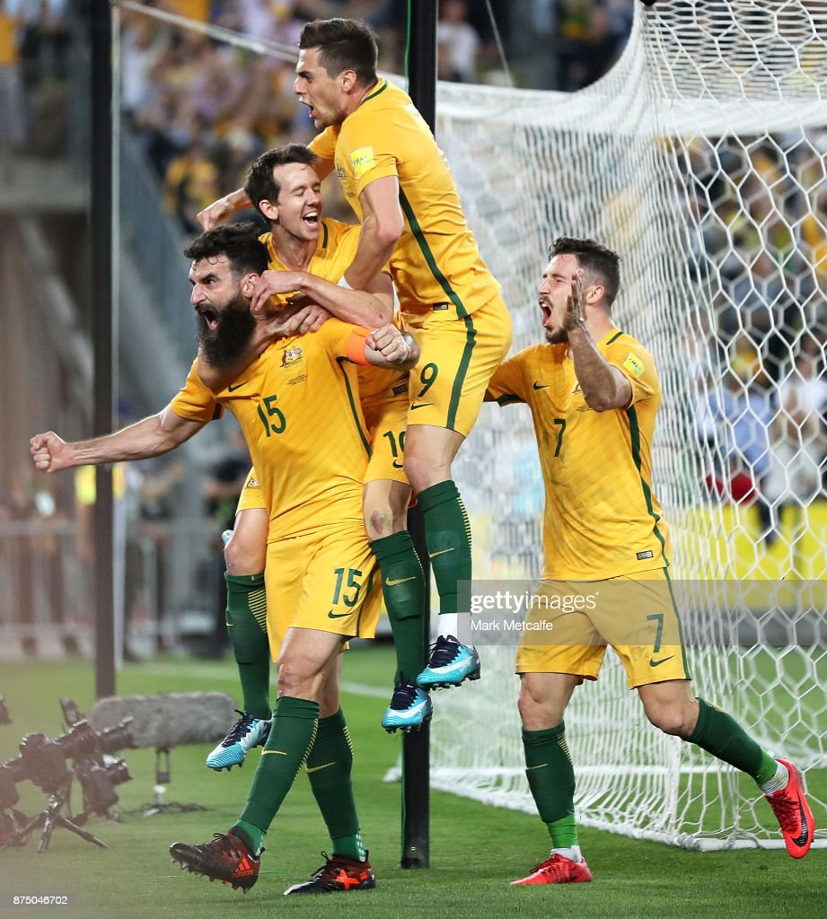 Mile Jedinak of Australia celebrates with team mates after scoring a goal during the 2018 FIFA World Cup Qualifiers Leg 2 match between the Australian Socceroos and Honduras at ANZ Stadium on November 15, 2017 in Sydney, Australia.