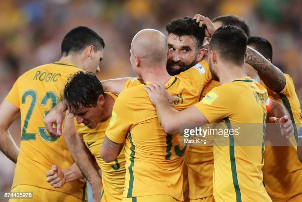 Mile Jedinak of Australia celebrates with team mates after scoring the first goal during the 2018 FIFA World Cup Qualifiers Leg 2 match between the...
