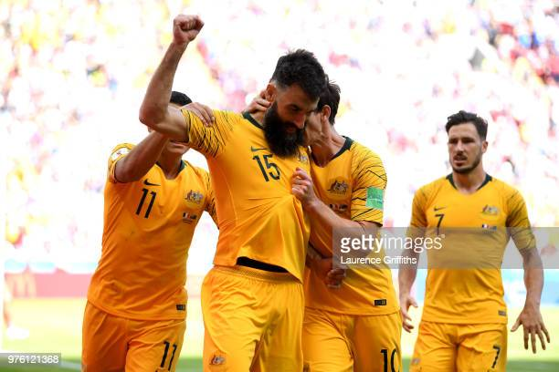 Mile Jedinak of Australia celebrates with team mates after scoring his team's first goal during the 2018 FIFA World Cup Russia group C match between...
