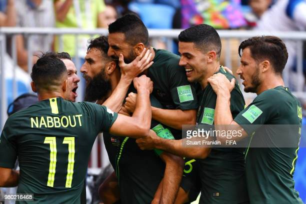 Mile Jedinak of Australia celebrates with team mates Andrew Nabbout Mathew Leckie and Mark Milligan after scoring his team's first goal during the...