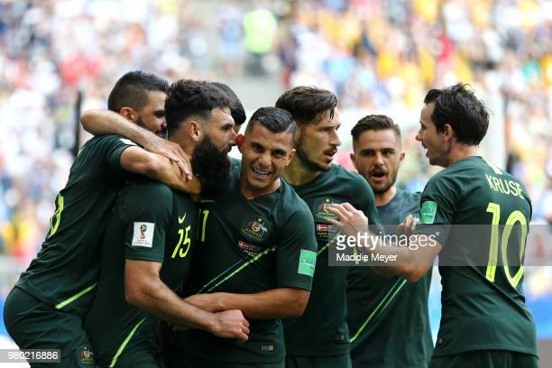 Mile Jedinak of Australia celebrates with team mates Andrew Nabbout Mathew Leckie Robbie Kruse and Mark Milligan after scoring his team's first goal...