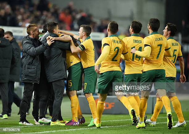 Mile Jedinak of Australia celebrates with teammates after scoring his team's second goal during the International Friendly match between Germany and...