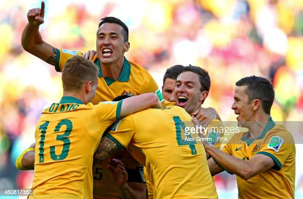 Mile Jedinak of Australia celebrates with team-mates after scoring the team's second goal from the penalty spot during the 2014 FIFA World Cup Brazil...
