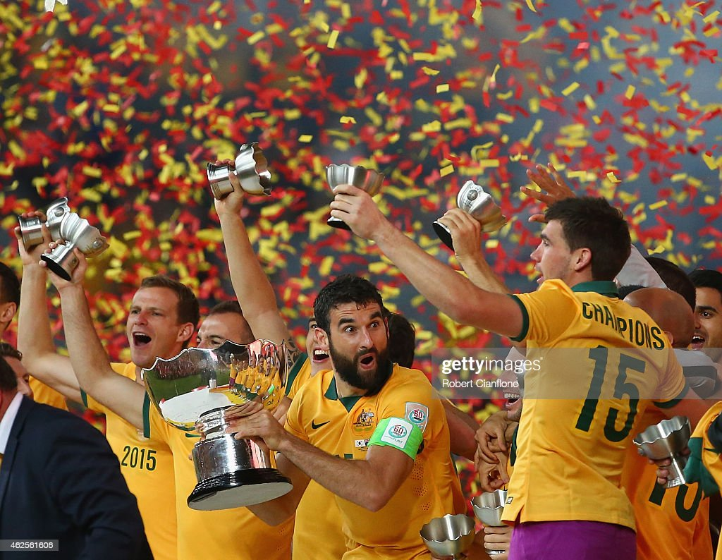 Mile Jedinak of Australia celebrates with the winners trophy after Australia defeated Korea republic at the 2015 Asian Cup final match between Korea Republic and the Australian Socceroos at ANZ Stadium on January 31, 2015 in Sydney, Australia.