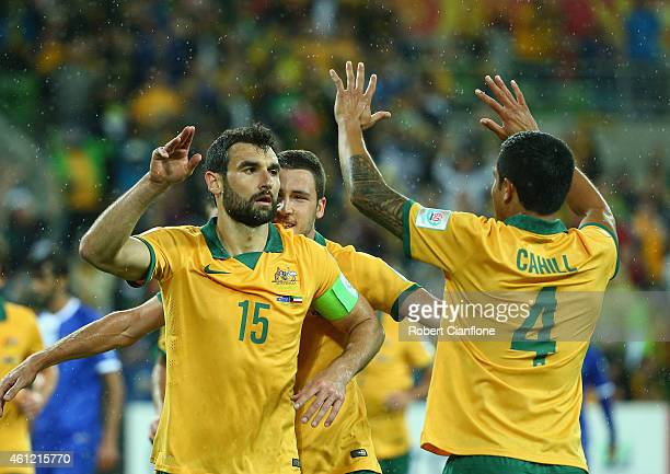 Mile Jedinak of Australia celebrates with Tim Cahill after he scored a penalty during the 2015 Asian Cup match between the Australian Socceroos and...