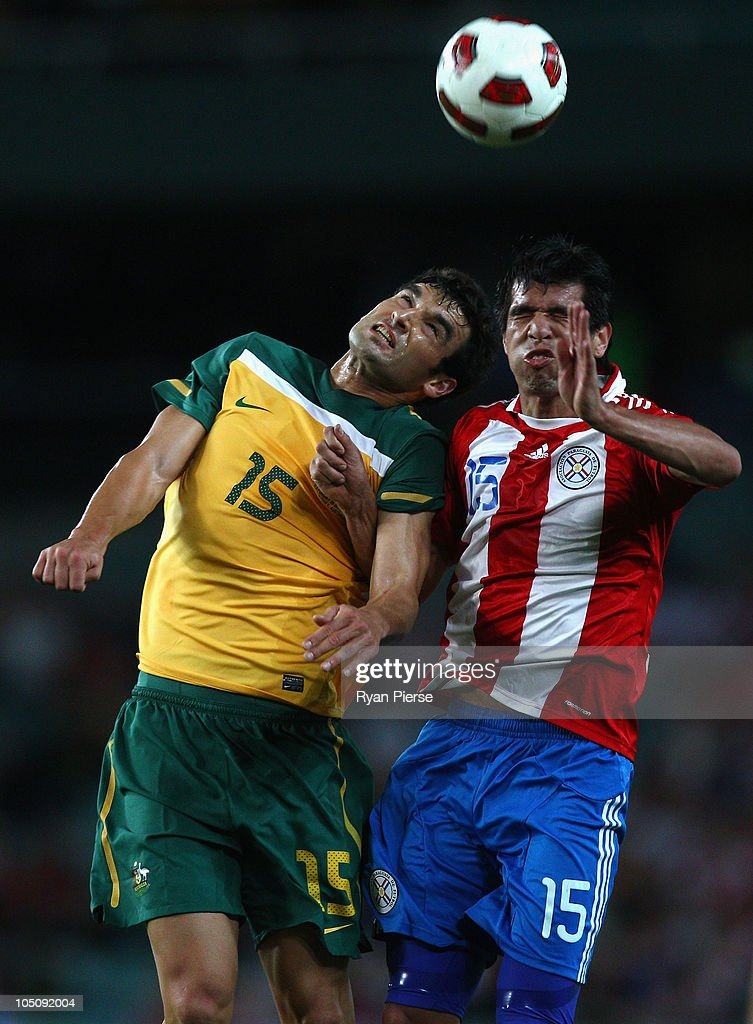 Mile Jedinak of Australia competes for the ball against Victor Caceres of Paraguay during the friendly match between the Australian Socceroos and Paraguay at the Sydney Football Stadium on October 9, 2010 in Sydney, Australia.