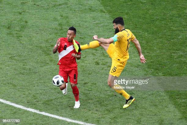Mile Jedinak of Australia fouls Christian Cueva of Peru during the 2018 FIFA World Cup Russia group C match between Australia and Peru at Fisht...