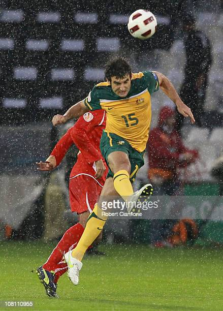 Mile Jedinak of Australia heads the ball during the AFC Asian Cup Group C match between the Australian Socceroos and Bahrain at AlSadd Stadium on...
