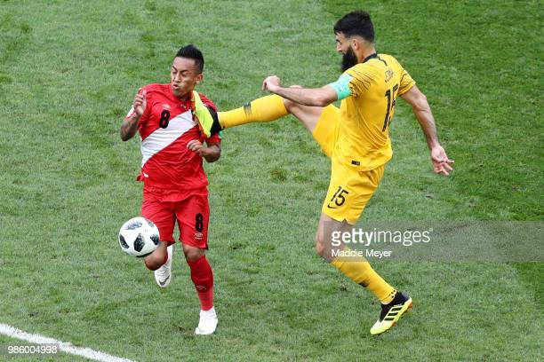 Mile Jedinak of Australia kicks Christian Cueva of Peru during the 2018 FIFA World Cup Russia group C match between Australia and Peru at Fisht...