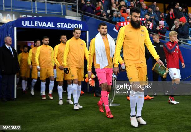 Mile Jedinak of Australia leads the team out prior to the International Friendly match between Norway and Australia at Ullevaal Stadion on March 23...