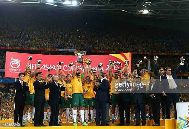 Mile Jedinak of Australia lifts the trophy during the 2015 Asian Cup final match between Korea Republic and the Australian Socceroos at ANZ Stadium...