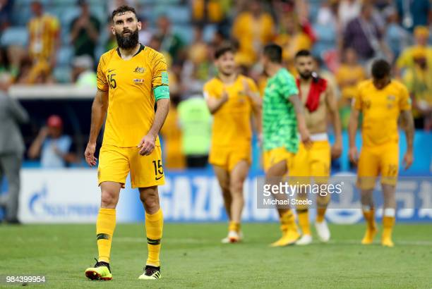 Mile Jedinak of Australia looks dejected following his sides defeat in the 2018 FIFA World Cup Russia group C match between Australia and Peru at...
