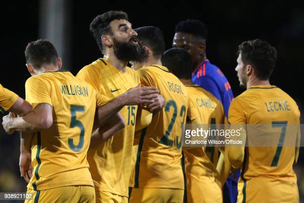 Mile Jedinak of Australia negotiates the position of the wall with goalkeeper Daniel Vukovic during the International Friendly match between...