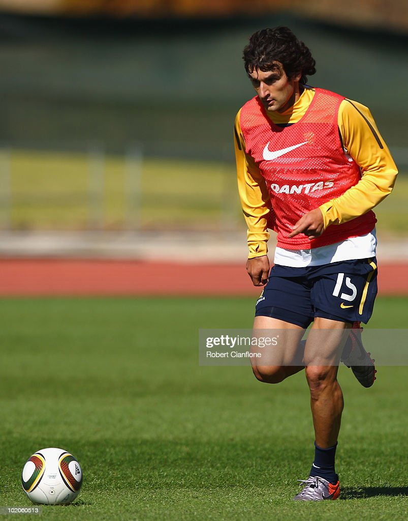 Mile Jedinak of Australia runs with the ball during an Australian Socceroos training session at Ruimsig Stadium on June 14, 2010 in Roodepoort, South Africa.
