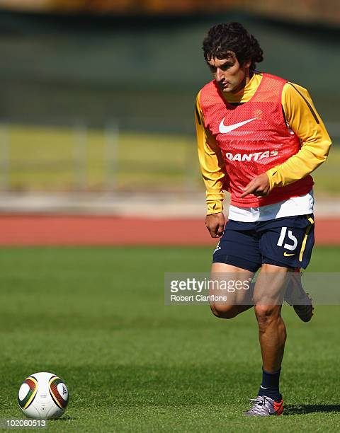 Mile Jedinak of Australia runs with the ball during an Australian Socceroos training session at Ruimsig Stadium on June 14 2010 in Roodepoort South...