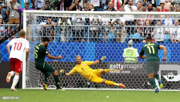 Mile Jedinak of Australia scores past Kasper Schmeichel of Denmark his team's first goal from the penalty spot during the 2018 FIFA World Cup Russia...