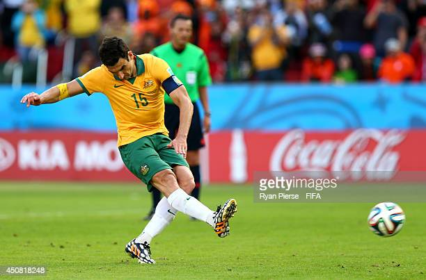 Mile Jedinak of Australia scores the team's second goal from the penalty spot during the 2014 FIFA World Cup Brazil Group B match between Australia...
