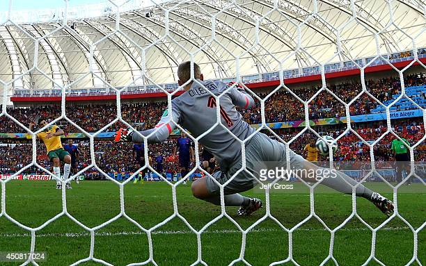 Mile Jedinak of Australia shoots and scores his team's second goal on a penalty kick past Jasper Cillessen of the Netherlands during the 2014 FIFA...
