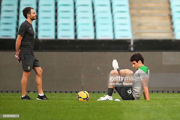 Mile Jedinak of Australia stretches during an Australian Socceroos training session at ANZ Stadium on May 25 2014 in Sydney Australia