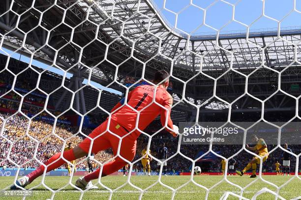 Mile Jedinak of Australia takes a penalty and scores his side's first goal past Hugo Lloris of France during the 2018 FIFA World Cup Russia group C...