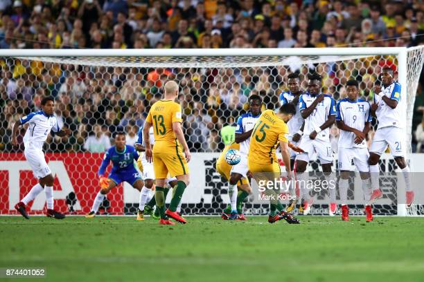 Mile Jedinak of Australia takes a penalty kick resulting in goal during the 2018 FIFA World Cup Qualifiers Leg 2 match between the Australian...