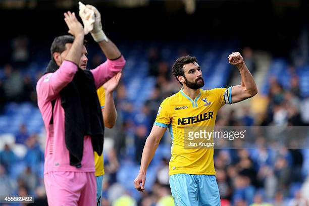 Mile Jedinak of Crystal Palace and his teammates applaud the travelling fans following their team's 32 victory during the Barclays Premier League...