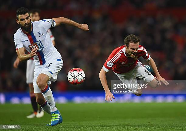 Mile Jedinak of Crystal Palace and Juan Mata of Manchester United in action during the Barclays Premier League match between Manchester United and...