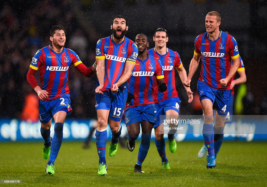 Mile Jedinak of Crystal Palace celebrates scoring his team's third goal with team mates during the Barclays Premier League match between Crystal Palace and Liverpool at Selhurst Park on November 23, 2014 in London, England.
