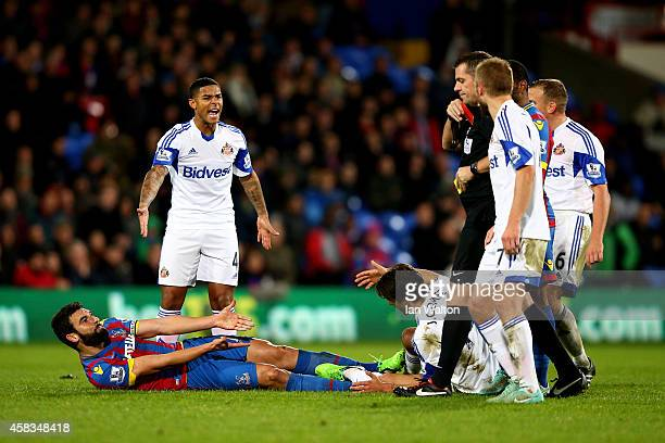 Mile Jedinak of Crystal Palace fouls Jordi Gomez of Sunderland leading to his red card for a second bookable offence during the Barclays Premier...