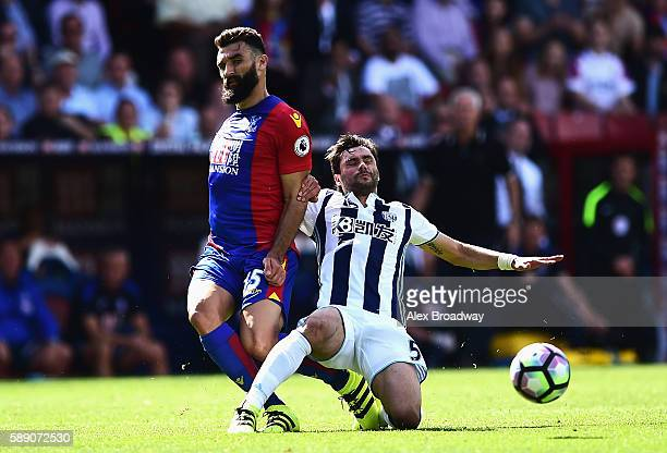 Mile Jedinak of Crystal Palace is tackled by Claudio Yacob of West Bromwich Albion during the Premier League match between Crystal Palace and West...