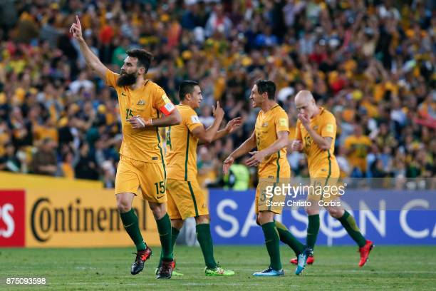 Mile Jedinak of the Australia celebrates with teammates after scoring the first goal during the 2nd leg of the 2018 FIFA World Cup Qualifier between...