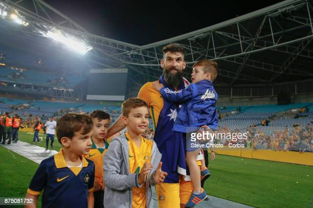 Mile Jedinak of the Australia on the lap of honour with his kids during the 2nd leg of the 2018 FIFA World Cup Qualifier between the Australia and...
