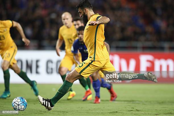 Mile Jedinak of the Socceroos shoots from the penalty spot as he scores Australia's first goal during the 2018 FIFA World Cup Qualifier match between...