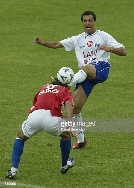 Mile Jedinak of United challenges Zeljko Susa of South Melbourne for the ball during the NSL round 16 match between Sydney United and South Melbourne...