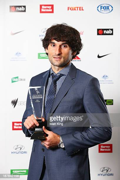 Mile Jedinak poses after winning the male Footballer of the Year award during the 2013 Australian Football Awards at Sydney Convention & Exhibition...