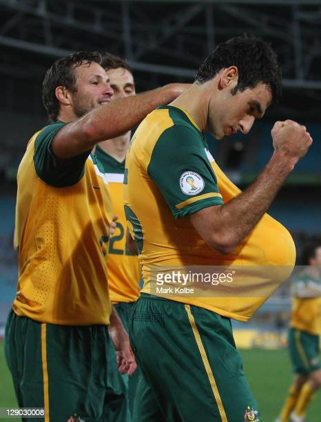 Mile Jedinak the Socceroos celebrates after scoring Australia's third goal during the FIFA World Cup Asian Qualifier match between the Australian...