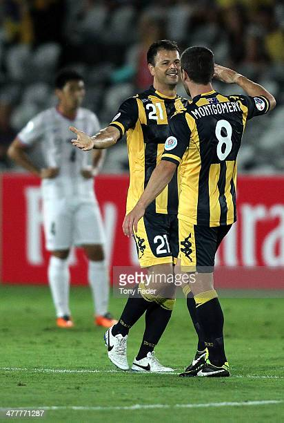 Mile Sterjovski of the Mariners celebrates a goal with team mate Nick Montgomery during the AFC Asian Champions League match between the Central...