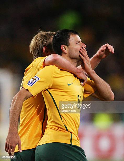 Mile Sterjovski of the Socceroos celebrates scoring with teammate David Carney during the 2010 FIFA World Cup Asian qualifying match between the...