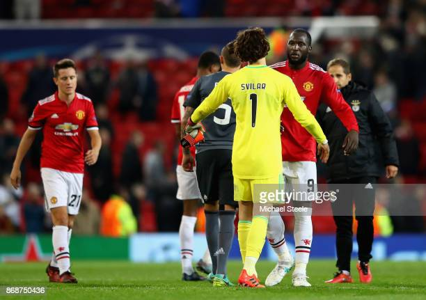 Mile Svilar of Benfica and Romelu Lukaku of Manchester United speak following the UEFA Champions League group A match between Manchester United and...