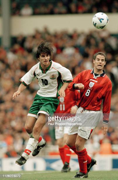 Milen Petkov of Bulgaria and Jamie Redknapp of England battle for the ball during a UEFA Euro 1998 Qualifiying match at Wembley Stadium on October 10...
