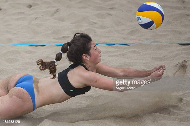 Milena Irina Churin and Michella di Cesare of Argentina dives for the ball during the Women's Beach Volleyball Qualification as part of the I ODESUR...