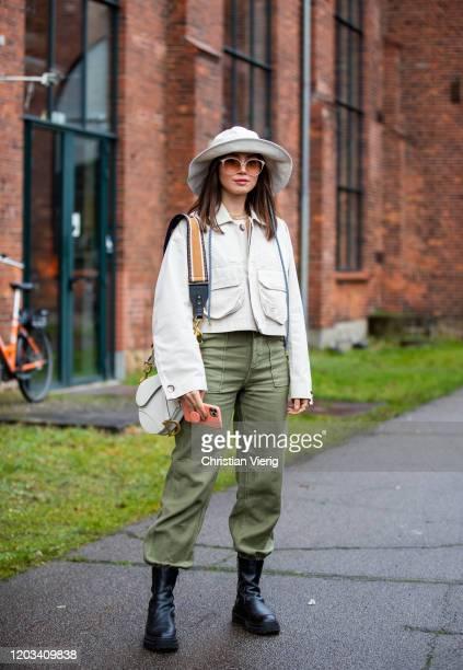 Milena Karl seen wearing hat, cropped jacket, green pants, Dior bag outside Baum und Pferdgarten during Copenhagen Fashion Week Autumn/Winter 2020...